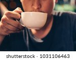 young man holding sip drinking... | Shutterstock . vector #1031106463