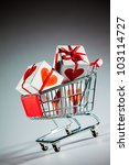 Small photo of shopping cart ahd gift