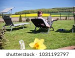 woman relaxing on a sun lounger ... | Shutterstock . vector #1031192797