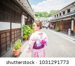 a young asian woman wearing... | Shutterstock . vector #1031291773