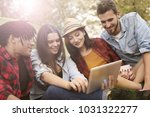 group of friends using a tablet | Shutterstock . vector #1031322277