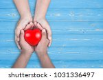love mom concept   woman holds...   Shutterstock . vector #1031336497
