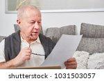 senior as retiree holds...   Shutterstock . vector #1031503057