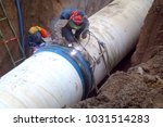 welders are welding large steel ... | Shutterstock . vector #1031514283