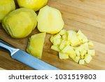 cut boiled potatoes to prepare... | Shutterstock . vector #1031519803