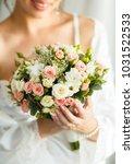 sweet wedding bouquet in the... | Shutterstock . vector #1031522533