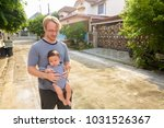 portrait of father and baby son ... | Shutterstock . vector #1031526367