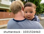 portrait of father and baby son ... | Shutterstock . vector #1031526463