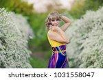 outdoor spring portrait of a... | Shutterstock . vector #1031558047