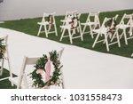outdoor wedding ceremony | Shutterstock . vector #1031558473