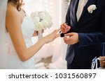 groom in a blue suit puts on a... | Shutterstock . vector #1031560897