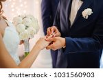 groom in a stylish suit puts on ... | Shutterstock . vector #1031560903
