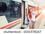 traveler girl waits train on... | Shutterstock . vector #1031578267