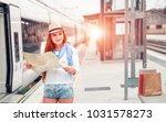 traveler girl waits train on... | Shutterstock . vector #1031578273
