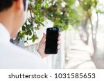 mobile phone with empty screen... | Shutterstock . vector #1031585653