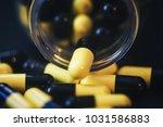 pills in capsules | Shutterstock . vector #1031586883