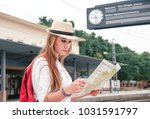 traveler girl with map  hat and ... | Shutterstock . vector #1031591797