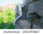 tap on a stone at outdoor | Shutterstock . vector #1031593867