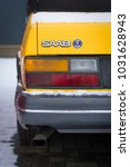 Small photo of OLDENZAAL, NETHERLANDS - JANUARY 15, 2017: Detail of a yellow vintage Saab 900 turbo S convertible in snowy conditions.
