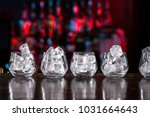 short cocktail glasses with ice ...   Shutterstock . vector #1031664643