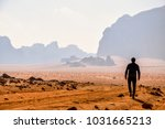 man travelling in the desert by ... | Shutterstock . vector #1031665213