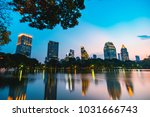 cityscape sunset of lakeside at ... | Shutterstock . vector #1031666743