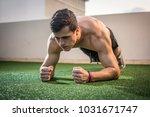 muscular man with strong... | Shutterstock . vector #1031671747