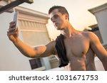 portrait of muscular young man... | Shutterstock . vector #1031671753