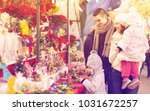 young parents with little girls ... | Shutterstock . vector #1031672257
