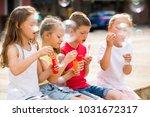 portrait of four children... | Shutterstock . vector #1031672317