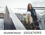 beautiful small girl walk with... | Shutterstock . vector #1031674393