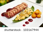 Duck breast dish with exotic garnish - stock photo