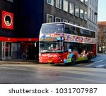 bright red hop on bus  tourist... | Shutterstock . vector #1031707987