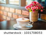 white cup of cappuccino coffee... | Shutterstock . vector #1031708053