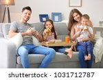 happy family having breakfast...   Shutterstock . vector #1031712787
