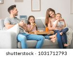 happy family having breakfast...   Shutterstock . vector #1031712793