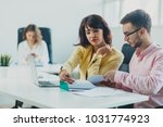 colleagues working at office in ... | Shutterstock . vector #1031774923