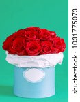 red roses flowers in a box on...   Shutterstock . vector #1031775073