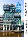 Small photo of ZAANDAM, NETHERLANDS - February 22, 2018: 160 rooms Inntel Hotel in Zaandam. The facade, an accumulation of almost seventy traditional 'Zaanse' houses becomes the striking feature of this building.