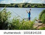 Fisherman Cast Fishing Rod In...