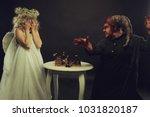 furious demon scatters chessmen   Shutterstock . vector #1031820187