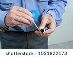 plumber putting teflon on the...   Shutterstock . vector #1031822173