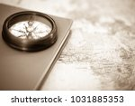 an old compass set on a guide... | Shutterstock . vector #1031885353