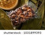 dried shiitake mushrooms in... | Shutterstock . vector #1031899393