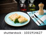 delicious stuffed pancakes on... | Shutterstock . vector #1031914627
