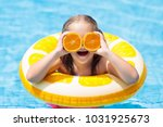 little girl in swimming pool... | Shutterstock . vector #1031925673
