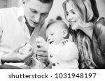 father holds a little yellow... | Shutterstock . vector #1031948197