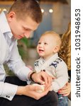 the father holds a little... | Shutterstock . vector #1031948653