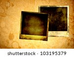 Blank instant photos on grunge paper background - stock photo