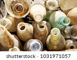 pile of dusty bottles | Shutterstock . vector #1031971057